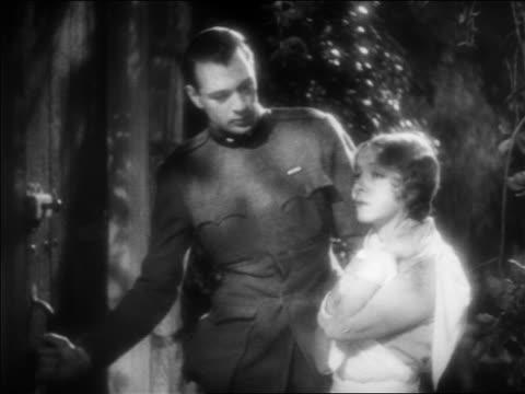 b/w 1932 man in ww i uniform nurse going thru door outdoors / feature - 1932 stock videos & royalty-free footage