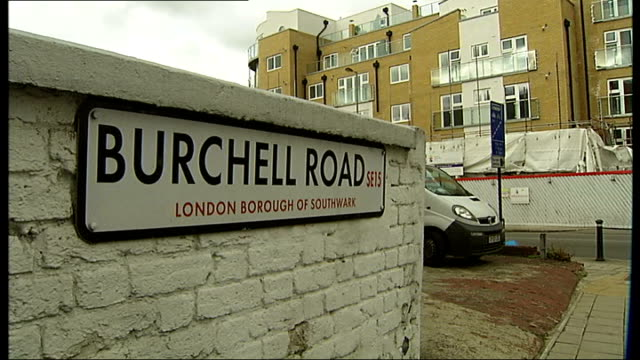 man injured in peckham shooting; england: london: peckham: ext reporter to camera 'burchell road' street sign general views of queens road traffic... - peckham stock videos & royalty-free footage