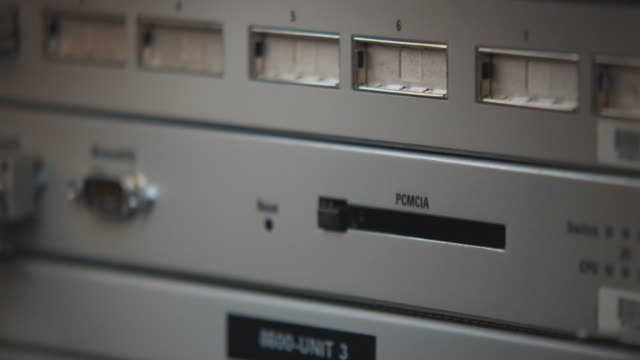 CU Man inserting PCMCIA Card into server, Sydney, Australia