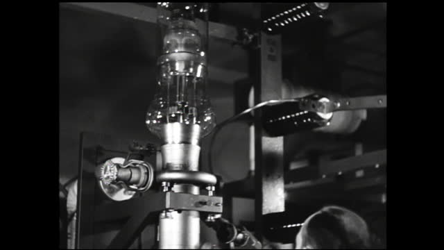 man inserting vacuum tubes into aging sockets on testing wall; woman testing vacuum tubes; hands adjusting dials and knobs on machine; older women... - 1940 1949 stock videos & royalty-free footage