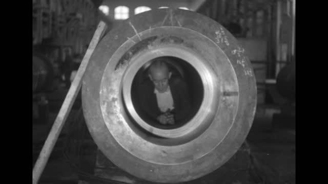 man inside large gun barrel inching himself out / note: exact day not known - gun barrel stock videos & royalty-free footage