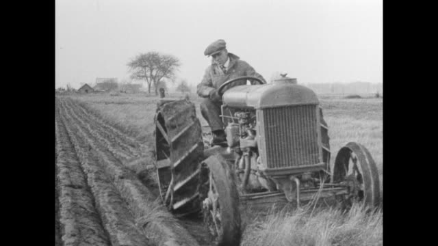 Man inspecting new Ford tractor / tractor plowing field