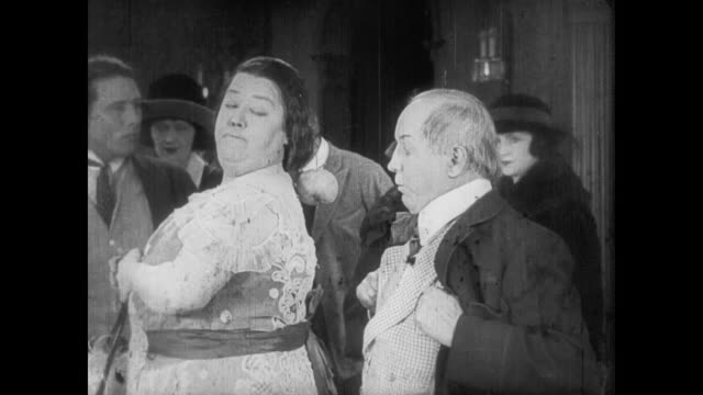 1922 man inspects hoof print shape on wealthy woman's back - scar stock videos and b-roll footage
