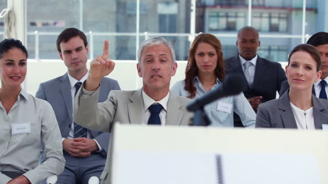 Man intervening at a meeting