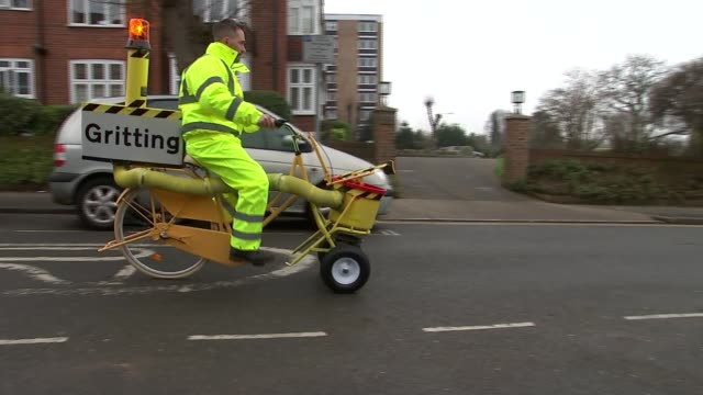 man invents world's first pedalpowered 'gritter bike' man invents world's first pedalpowered 'gritter bike' england london ext close shot of flashing... - flying goggles stock videos and b-roll footage