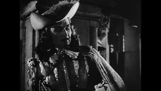 man (ralph canton) is annoyed by his inability to beat cyrano de bergerac - xvii° secolo video stock e b–roll