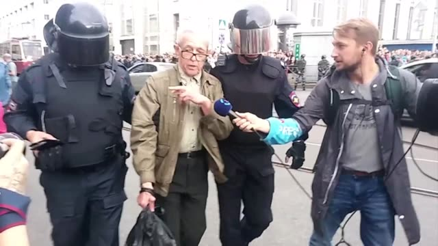 man is arrested during a demonstration against pension reform in saint petersburg russia - pension stock videos & royalty-free footage