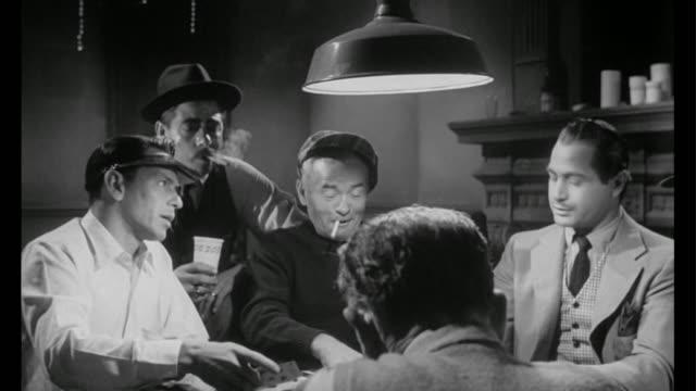 vidéos et rushes de 1955 man (frank sinatra) is back to dealing cards as illegal gambler - poker