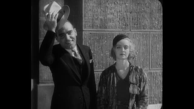 1932 a man is confused when a woman's (bette davis) fiancé (pat o'brien) says hi to him - fiancé stock videos and b-roll footage