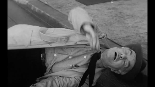1959 man is distracted by his thoughts walks into the road and is hit by a car - rinnsteinkante stock-videos und b-roll-filmmaterial
