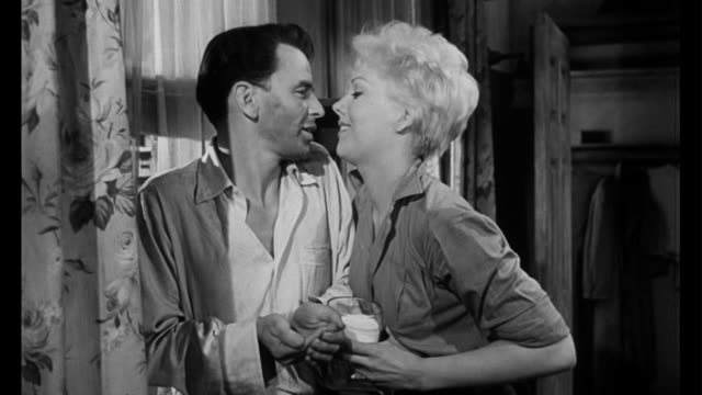 1955 Man (Frank Sinatra) is feeling better after having gone through detox with woman's (Kim Novak) help