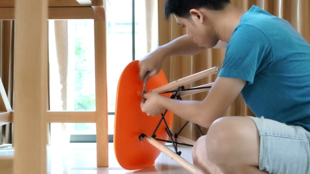 Man is installing DIY chair in the house
