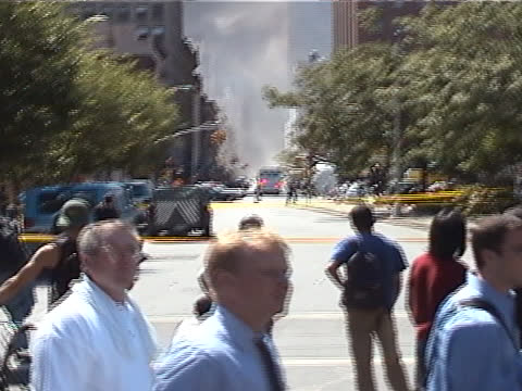 stockvideo's en b-roll-footage met man is interviewed on the streets of lower manhattan during the late afternoon on september 11th, 2001 in new york city, usa. the september 11... - september 11 2001 attacks