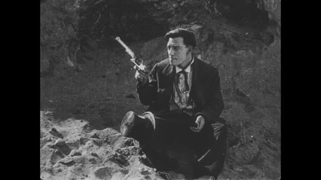 1918 Man (Buster Keaton) is involved in a shootout on the canyon