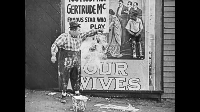 1919 Man (Fatty Arbuckle) is pestered by a young boy while pasting a theater poster, so he pastes the boys backside and affixes him to the wall