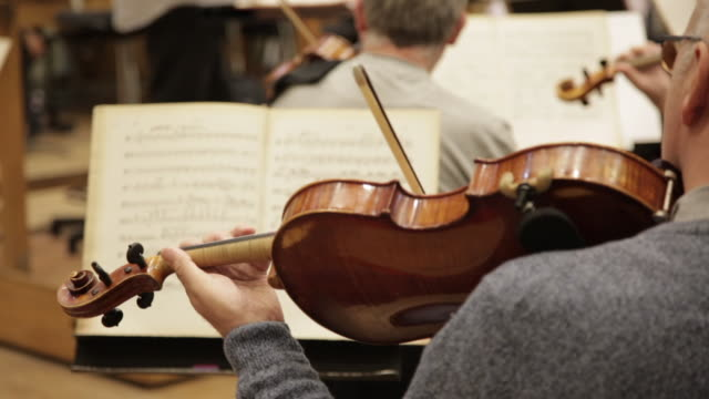 a man is playing on violin - performing arts event stock videos and b-roll footage