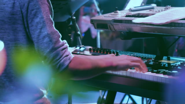 man is playing the piano. close up - synthesizer stock videos & royalty-free footage