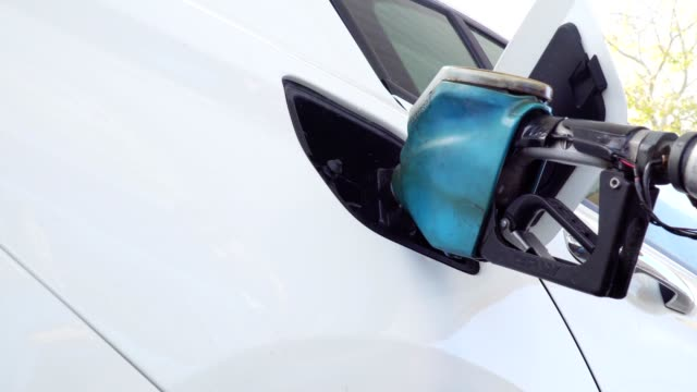 man is refuelling his car - refuelling stock videos & royalty-free footage