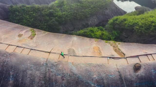 a man is running on the dangerous danxia mountain - natural landmark stock videos & royalty-free footage