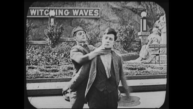 1917 man (buster keaton) is strangled on amusement park ride before being thrown - 1917 stock videos & royalty-free footage