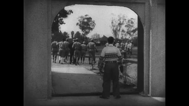 1927 Man (Buster Keaton) is surprised by a camouflaged door