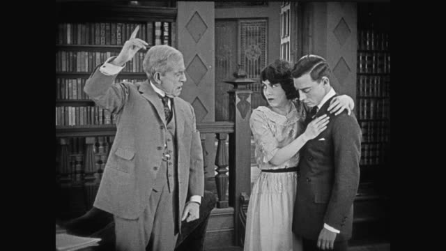 1920 man (buster keaton) is surprised when given check for million dollars - cheque financial item stock videos & royalty-free footage