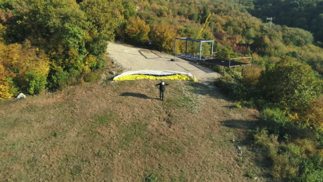 man is taking off to ride a paraglider - paragliding stock videos & royalty-free footage