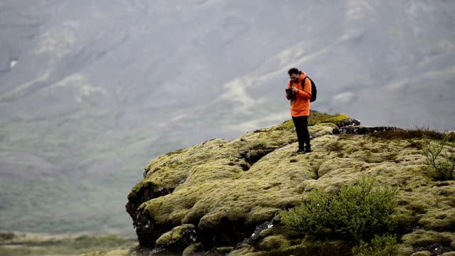 Man is taking photos in the nature in Iceland