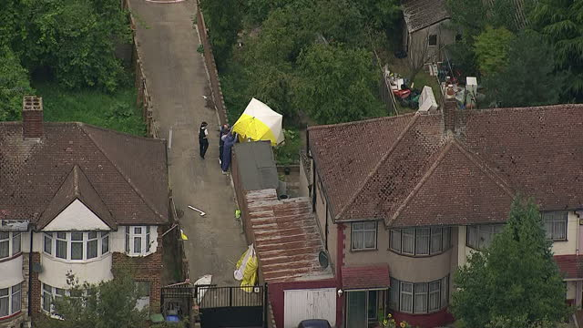 a man is under arrest after a woman was found beheaded in a garden in north london police say they received reports of a man with a knife who... - female beheading stock videos & royalty-free footage