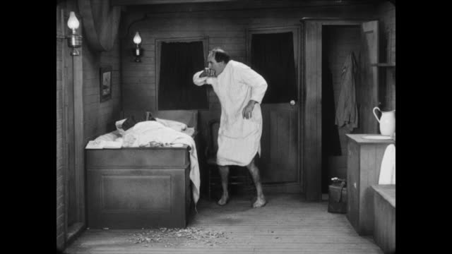 1928 a man (ernest torrence) is upset when he finds an empty bed - deception stock videos and b-roll footage