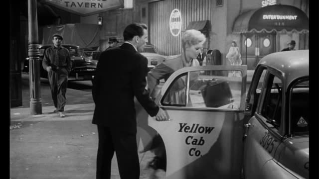 stockvideo's en b-roll-footage met 1955 man (frank sinatra) is upset when woman (kim novak) packs her bags and takes off - 1955