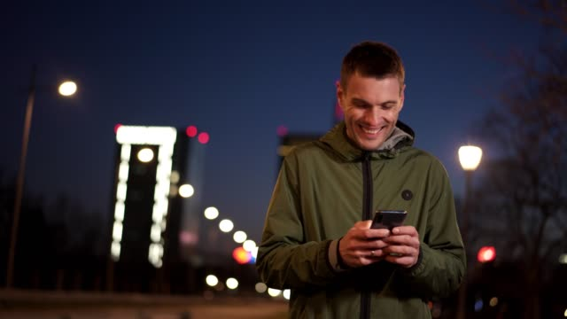 man is using smart phone at night - content stock videos & royalty-free footage