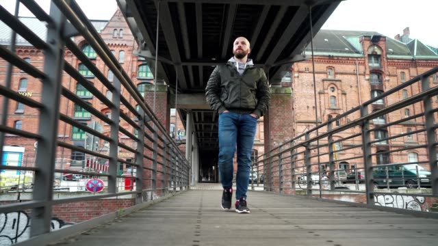 man is walking across the bridge - completely bald stock videos & royalty-free footage