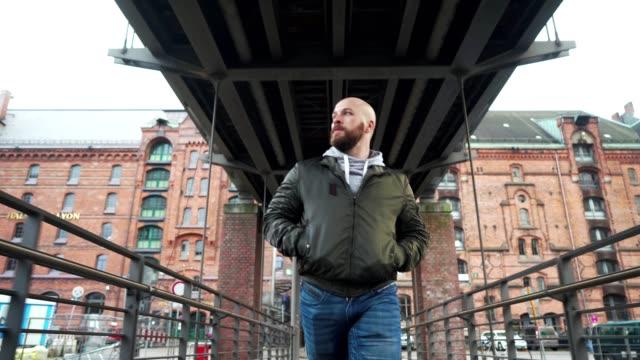 man is walking across the bridge - beard stock videos & royalty-free footage