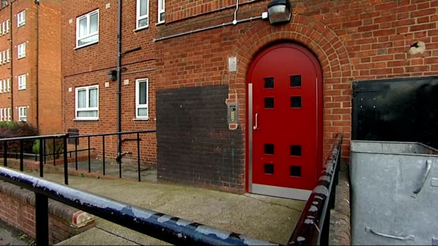 man jailed for murdering his 3 year old nephew; england: london: ext low angle view block of flats tilt down entrance to flats front door to block of... - 甥点の映像素材/bロール