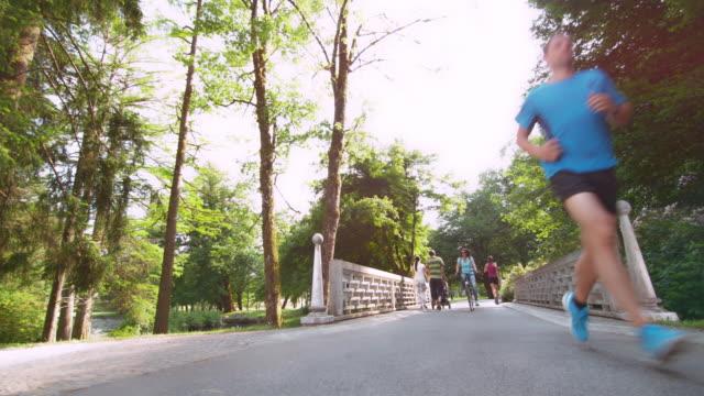 DS Man jogging across a bridge in the park