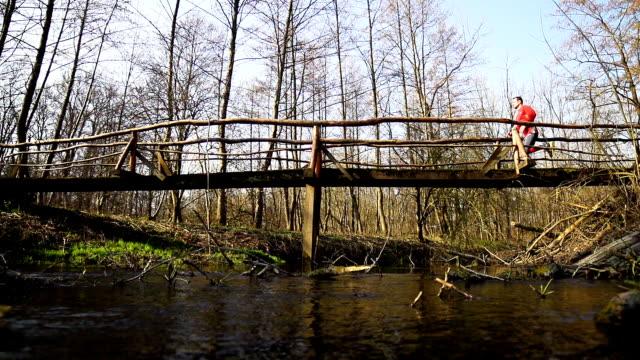 HD SUPER SLOW-MO: Man Jogging Across A Bridge