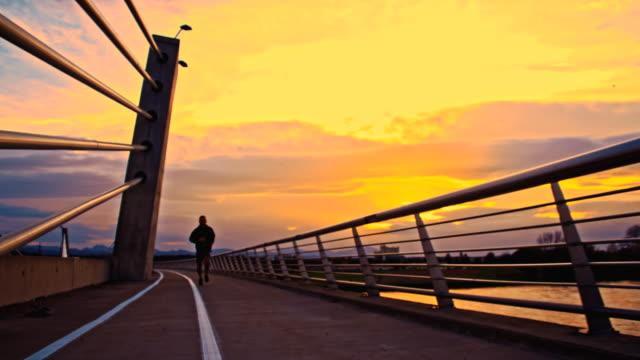 TS Man Jogging Across The Bridge