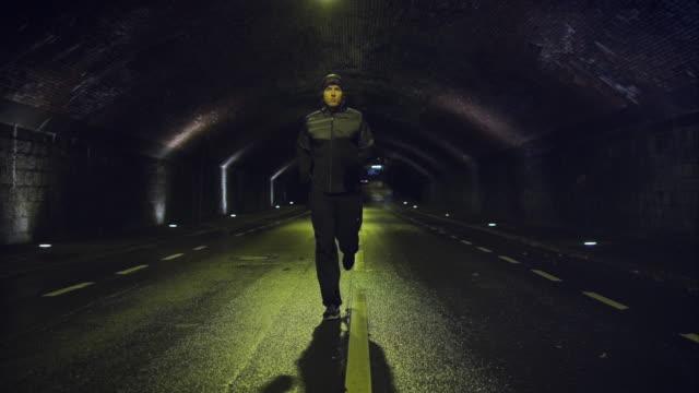 man jogging at night - athlete stock videos & royalty-free footage