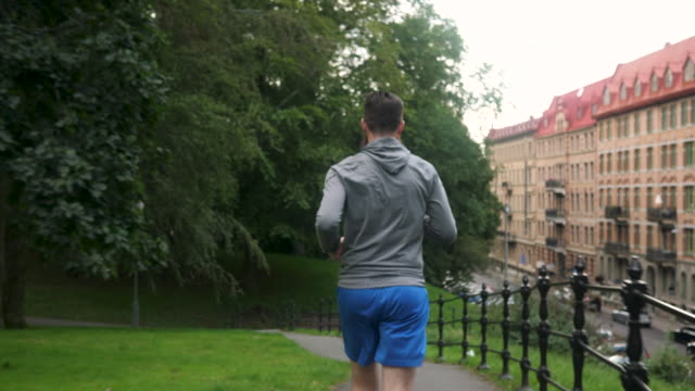 man jogging in a park - out of breath stock videos and b-roll footage