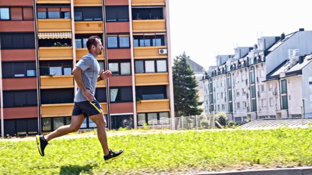 SLO MO Man jogging in the city