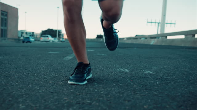 man jogging in urban setting - human foot stock videos and b-roll footage