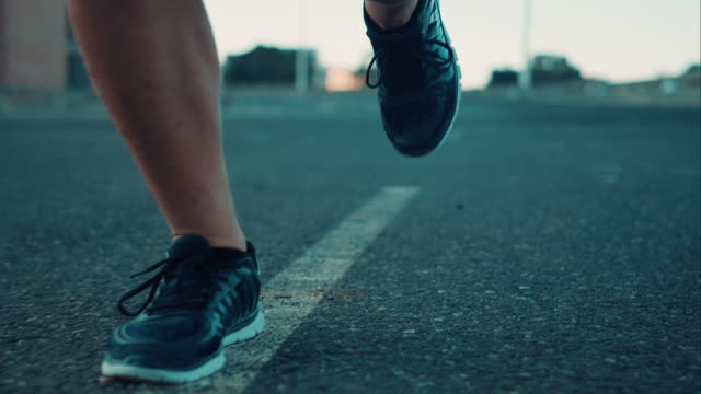 man jogging in urban setting - human foot stock videos & royalty-free footage