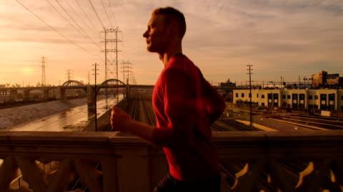 man jogging through los angeles - morning stock videos & royalty-free footage