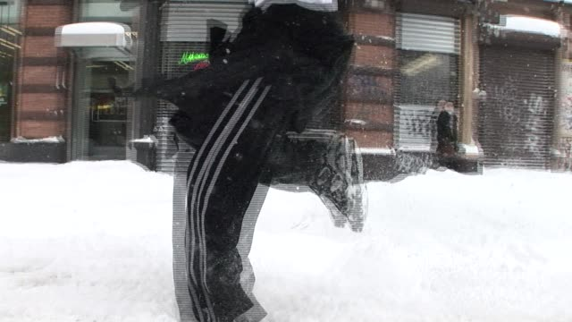 ms ts man jogging through snow on city street/ new york city - low section stock videos and b-roll footage