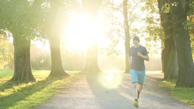man jogging - approaching stock videos & royalty-free footage