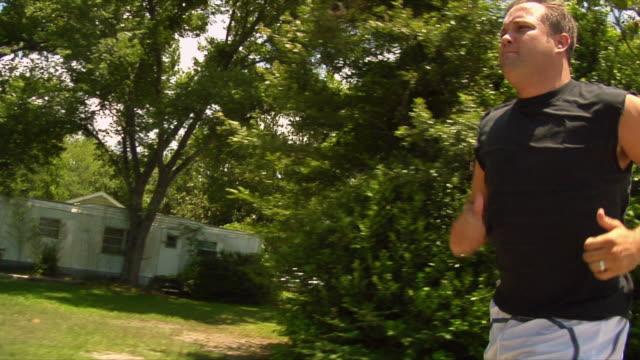ms td ts man jogging with prosthetic leg / wilmington, north carolina, usa - endast en man i 30 årsåldern bildbanksvideor och videomaterial från bakom kulisserna