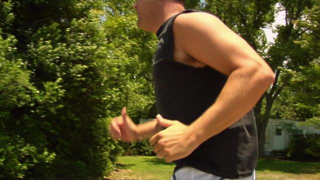 MS TD TS Man jogging with prosthetic leg / Wilmington, North Carolina, USA