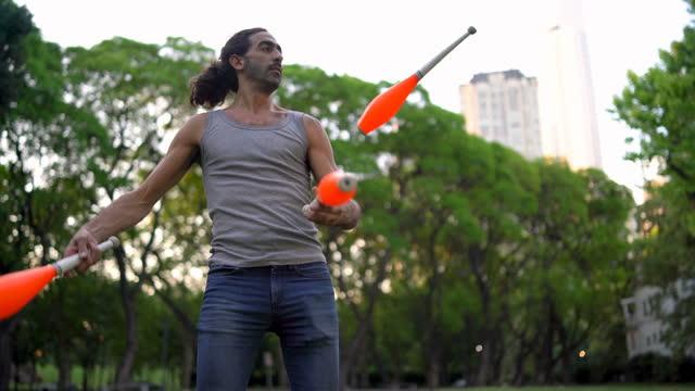man juggling cones in park - puerto madero stock videos & royalty-free footage