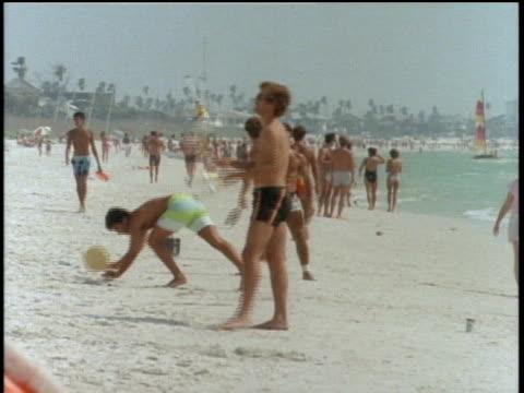 man juggling pins on florida beach - shirtless stock videos & royalty-free footage